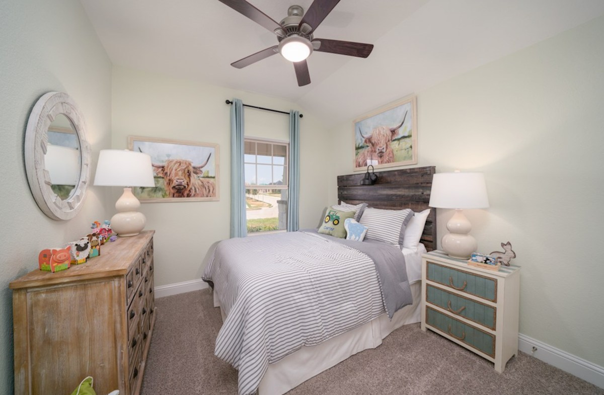 Amira  Maxwell guest bedroom with carpet floors and ceiling fan