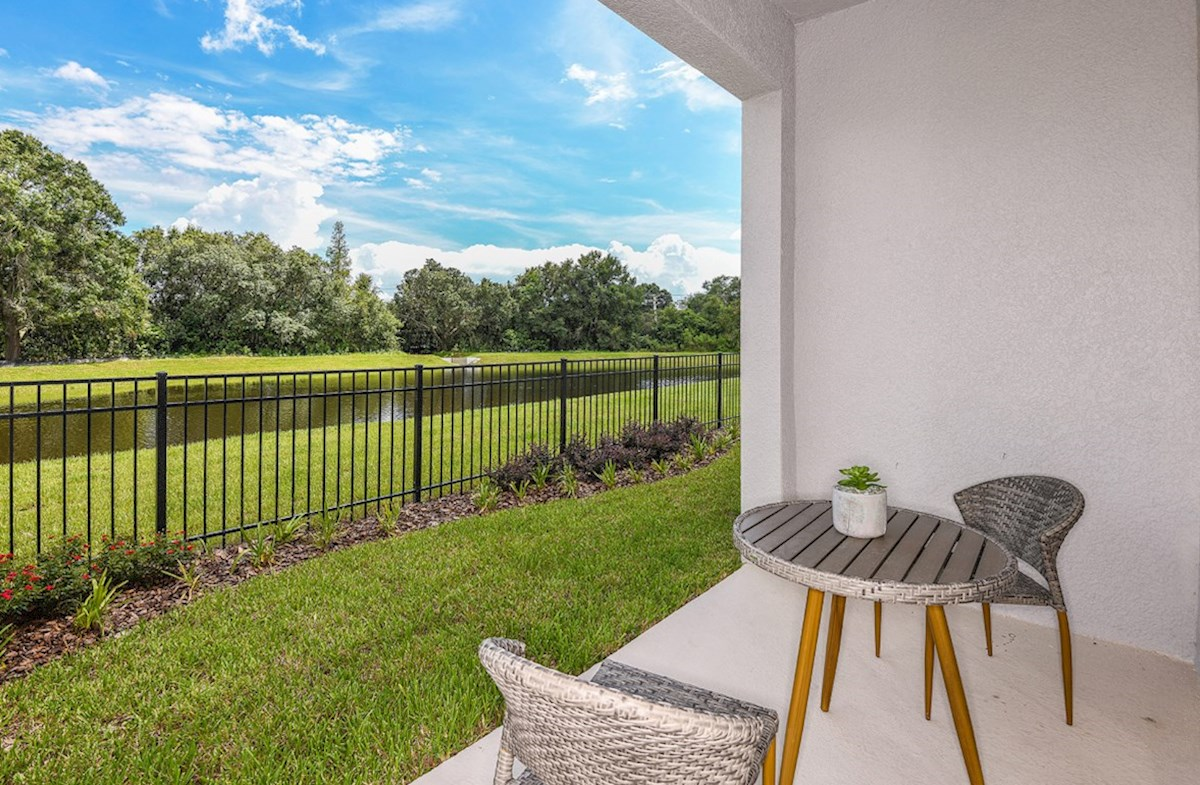 Kemerton Place Siesta Key Covered lanai with table and chairs