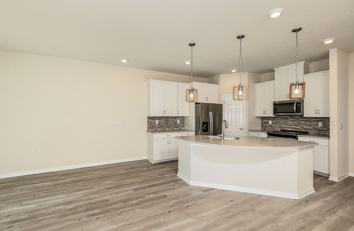 Siesta Key quick move-in Open kitchen and great room with laminate flooring