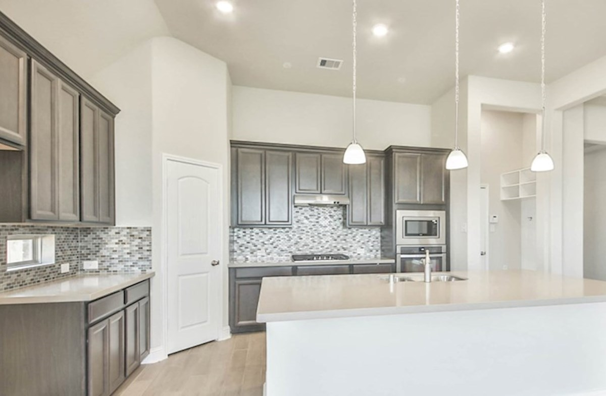 Madison quick move-in kitchen with stone island and tile floors