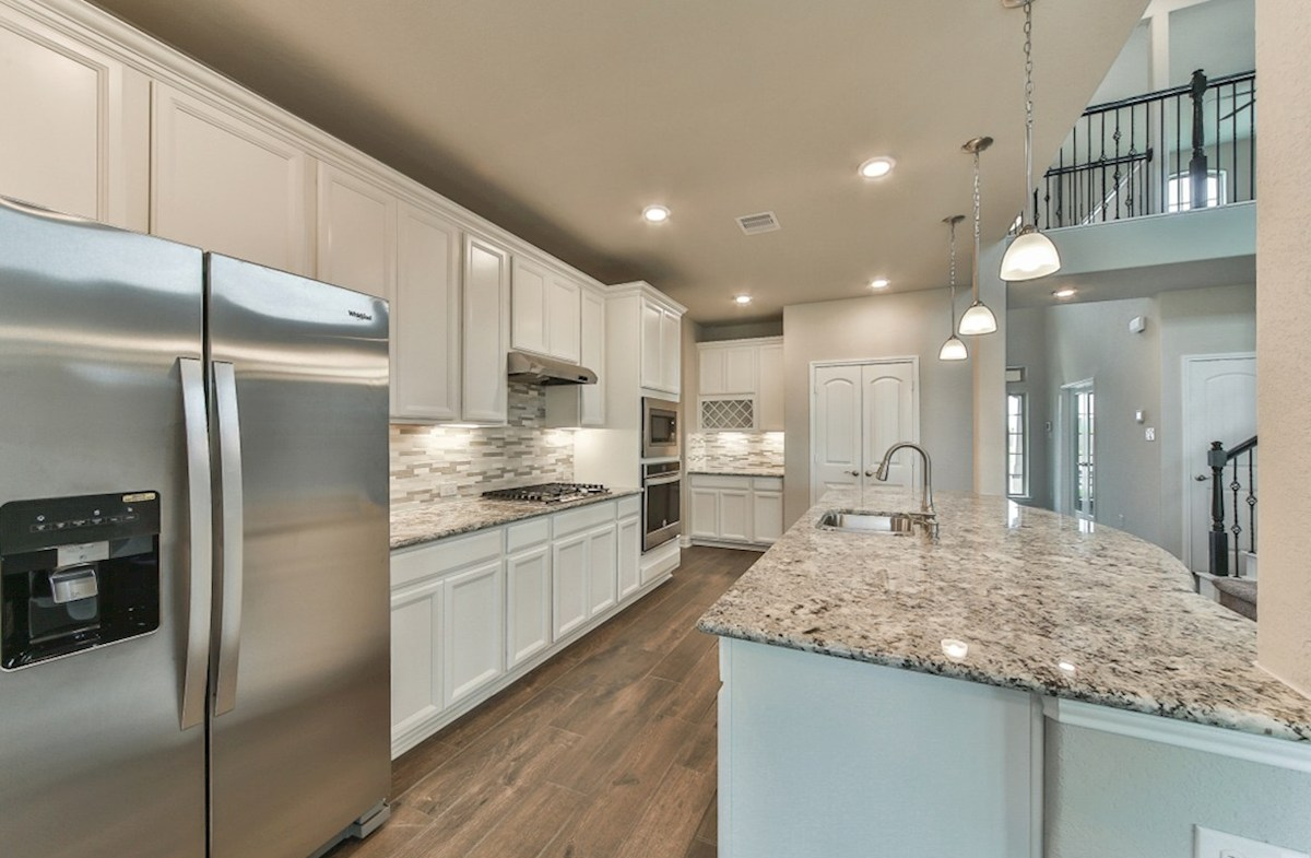 Armstrong quick move-in kitchen with granite countertops and pendant lighting