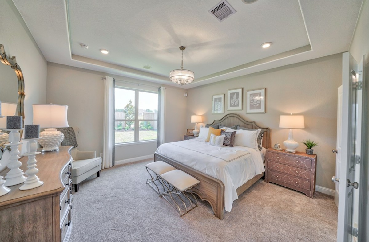 Young Ranch Armstrong master bedroom with tray ceiling
