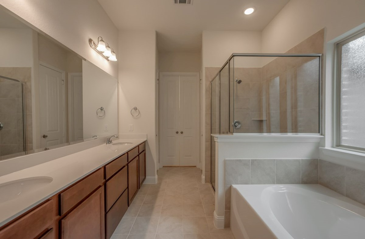 Brazos quick move-in master bathroom with walk-in shower and soaking tub