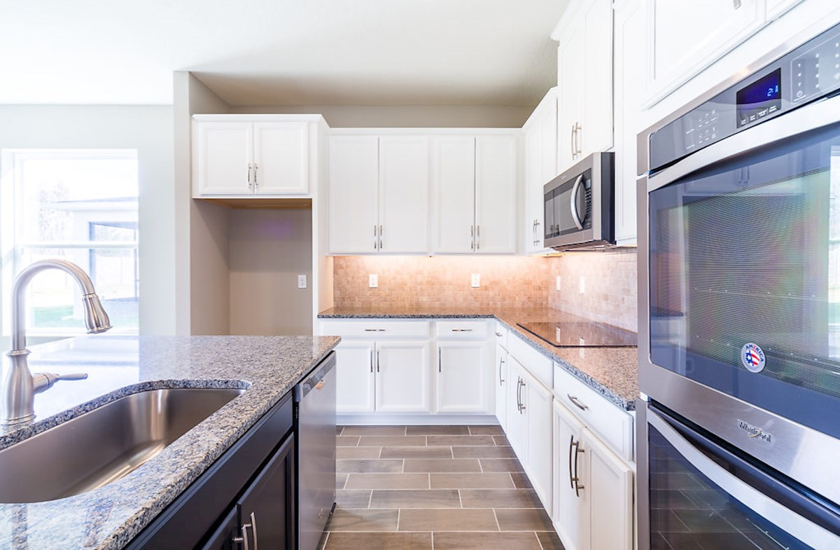 Captiva quick move-in Gourmet kitchen featuring linen cabinets