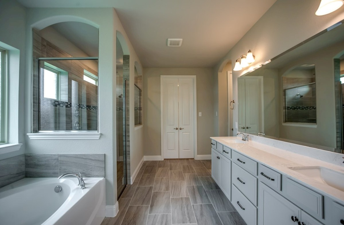 Trinity quick move-in master bath with walk-in shower, soaking tub and white cabinets
