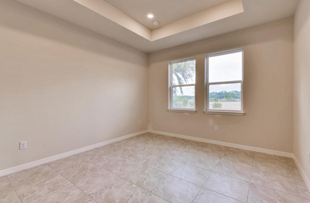 Sea Breeze quick move-in Masted bedroom with tile flooring