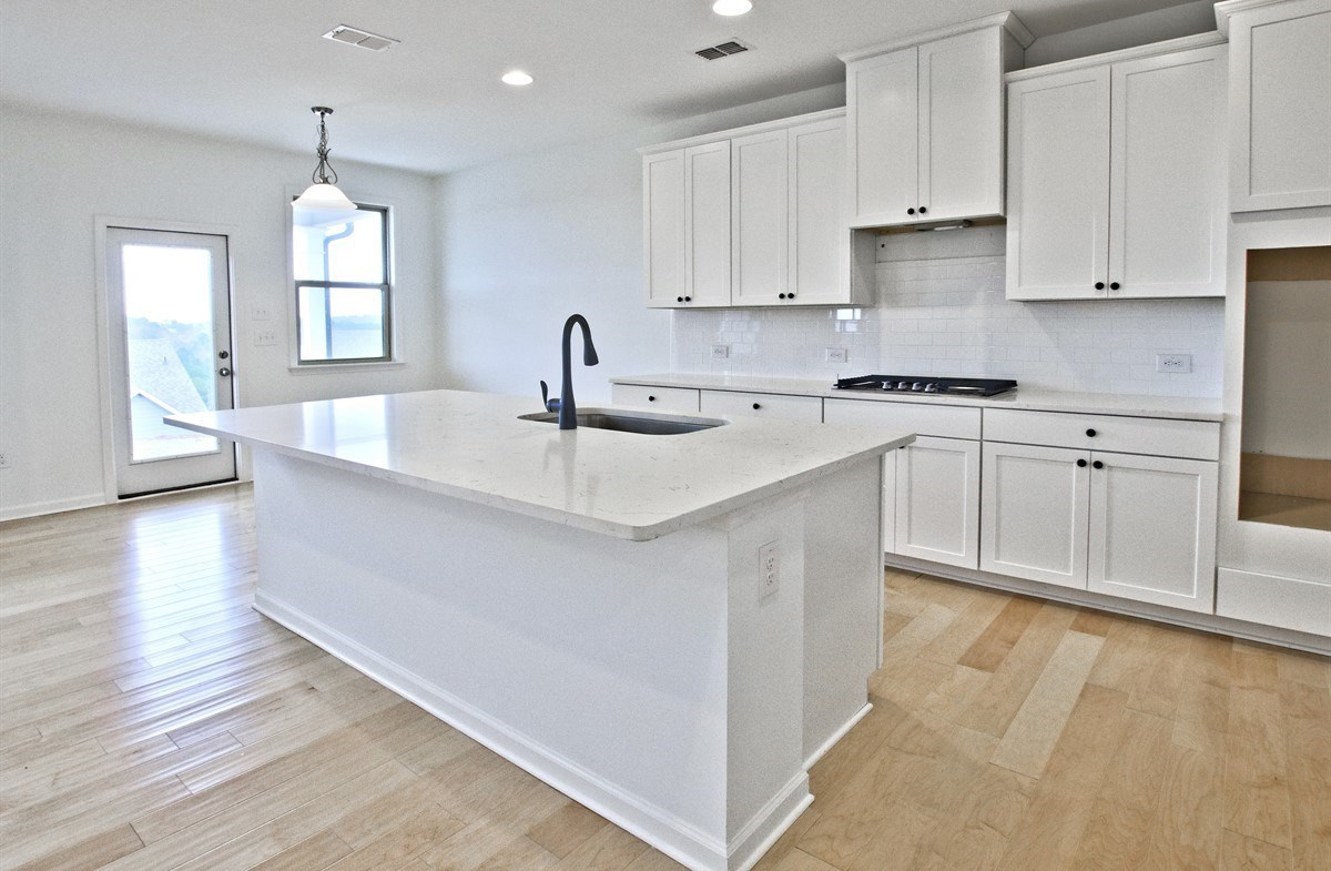 Laurel quick move-in Kitchen with white cabinets