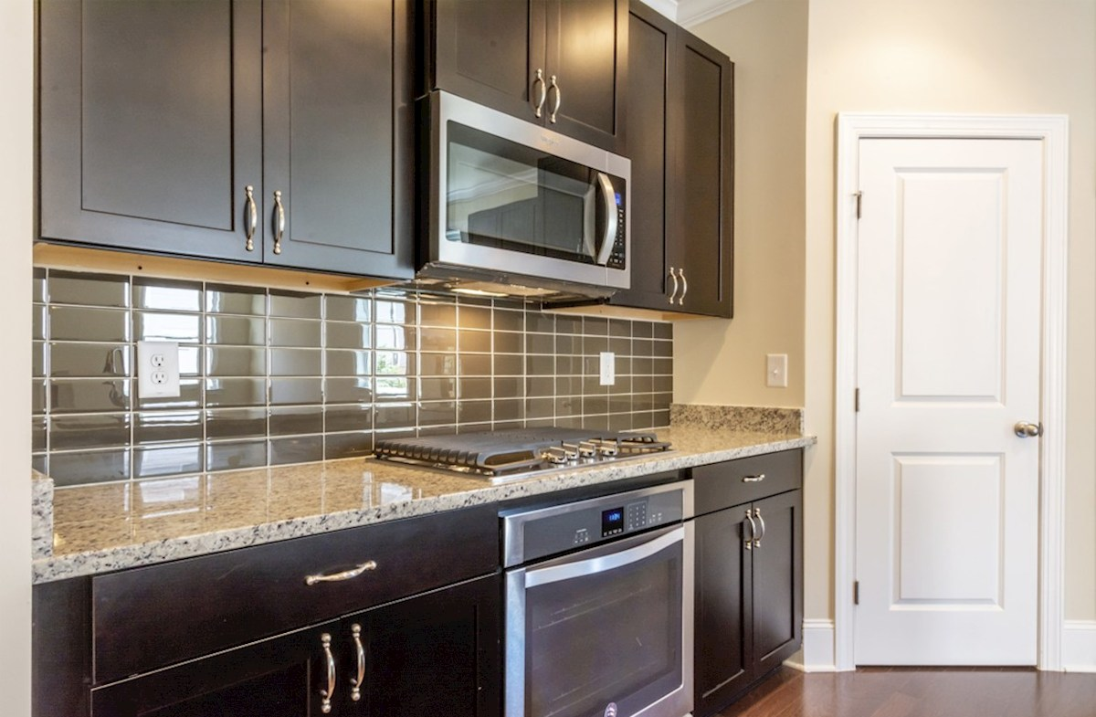 Langley quick move-in Kitchen with granite countertops