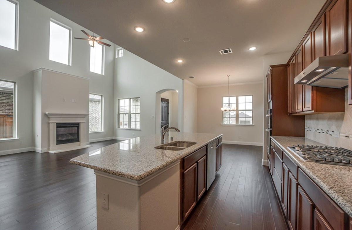 Brazos quick move-in open kitchen with large island that opens to great room