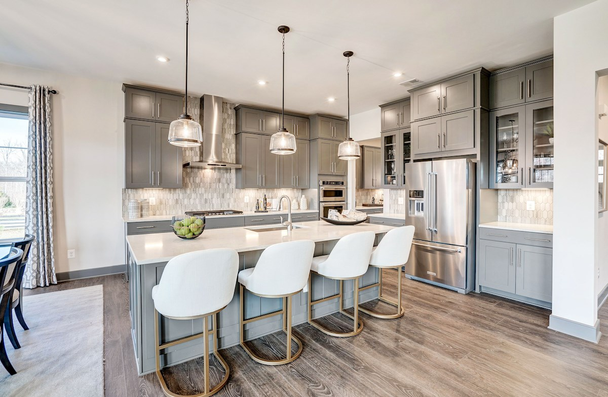 corner kitchen with gray cabinets & center island