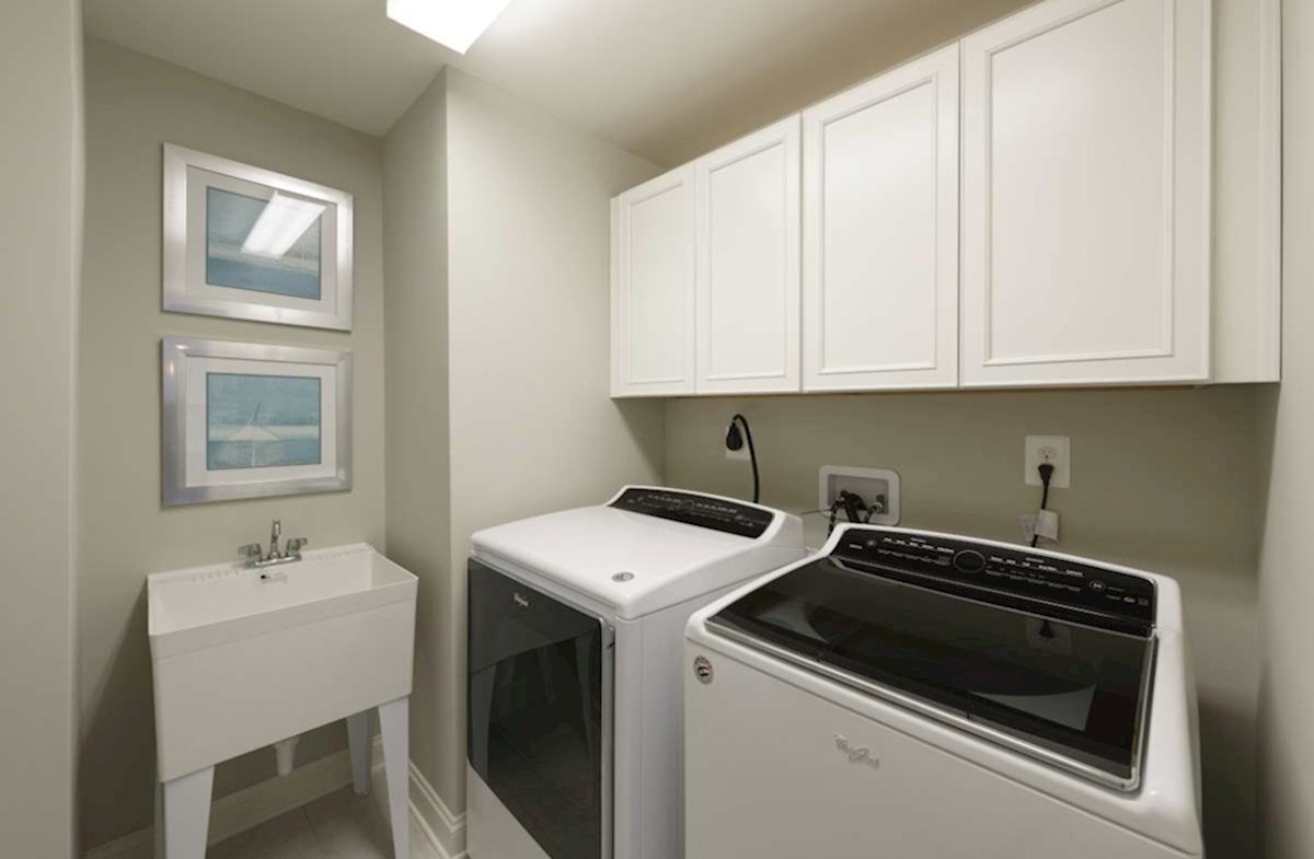 The Estuary Newport Large laundry room with extra cabinet space for storage