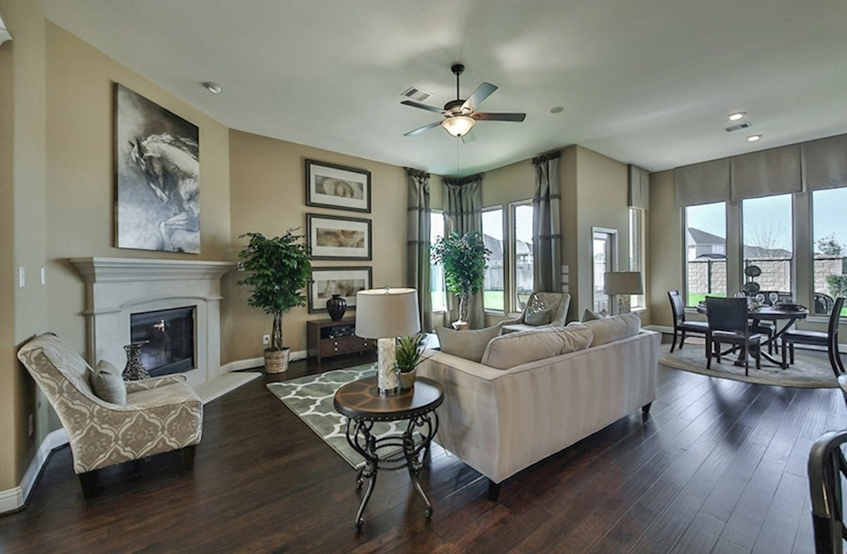Galveston quick move-in Galveston great room with wood flooring and stone fireplace