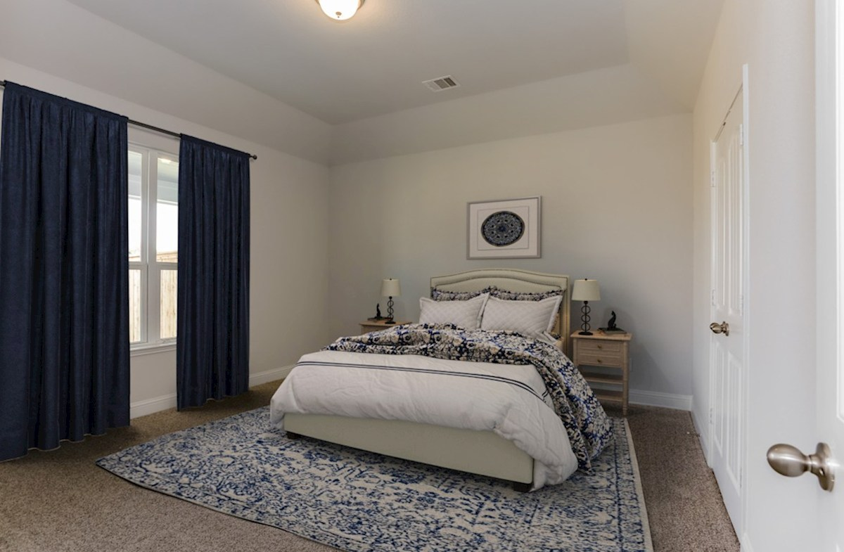 Bridgeland: Harmony Grove Spicewood master bedroom with carpet flooring