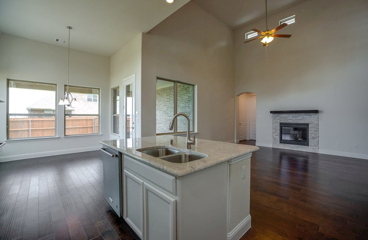 Richland quick move-in kitchen island overlooks to great room and breakfast area