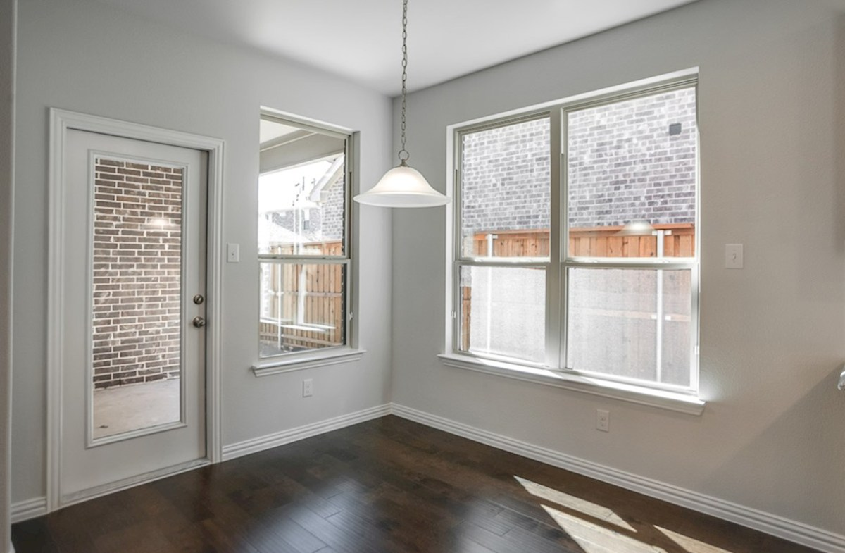 Whitney quick move-in breakfast nook with wood floors