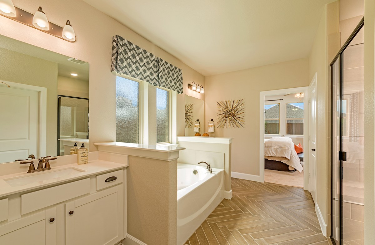 Laredo master bathroom with soaking tub and shower