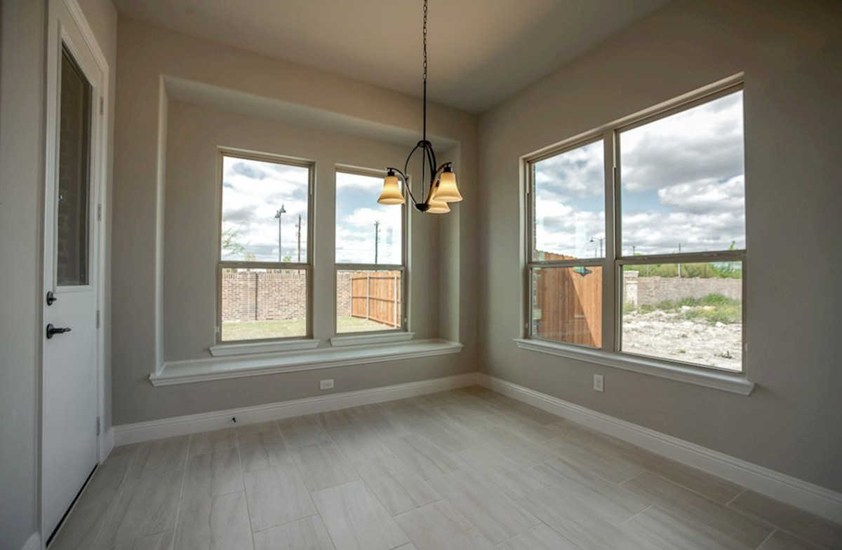 Summerfield quick move-in breakfast nook with windows and tile floor
