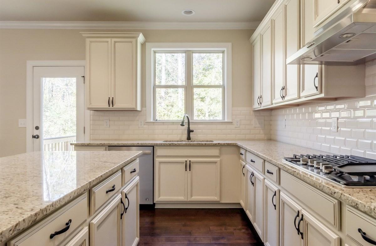 Stockton quick move-in Kitchen with white subway tile