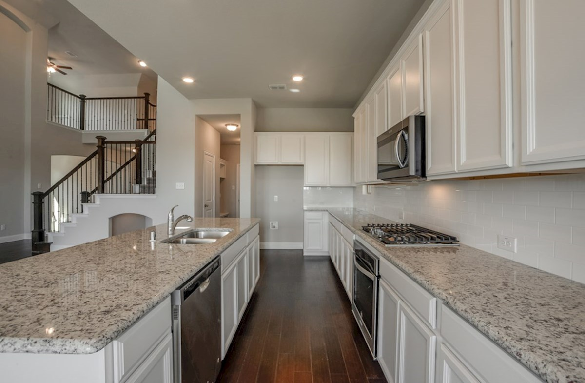 Summerfield quick move-in Summerfield kitchen with white cabinets and granite countertops