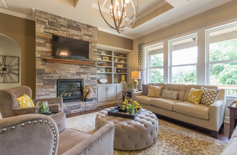 great room with floor-to-ceiling stone fireplace