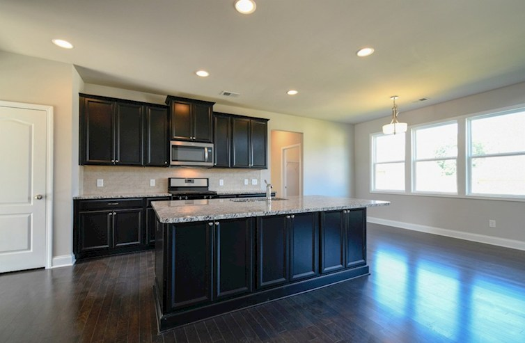 Kingsgate quick move-in Kitchen with dark cabinets