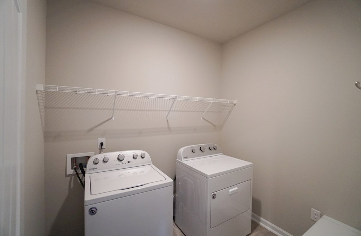 Georgetown quick move-in laundry room features washer and dryer