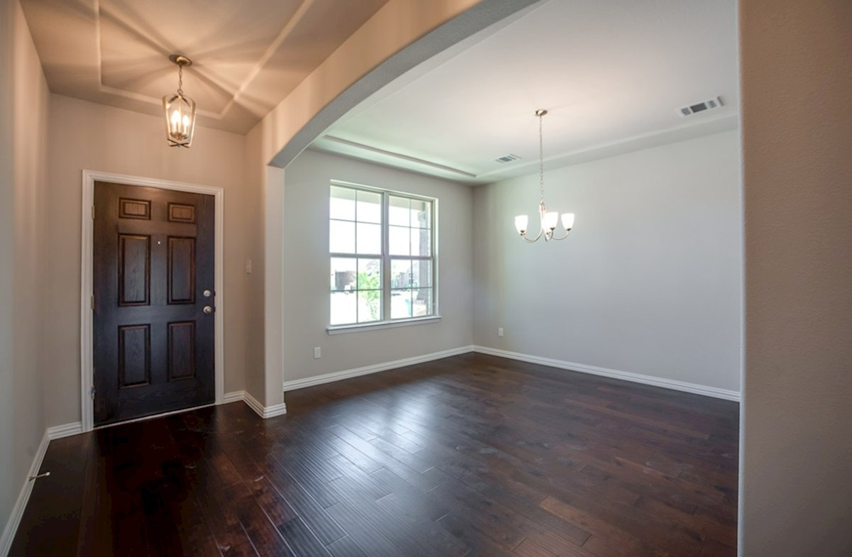 Prescott quick move-in dining room with wood flooring