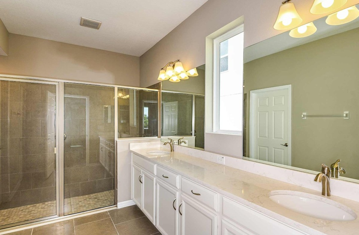 Shoreline quick move-in Master Bathroom with large glass enclosed shower and dual vanity