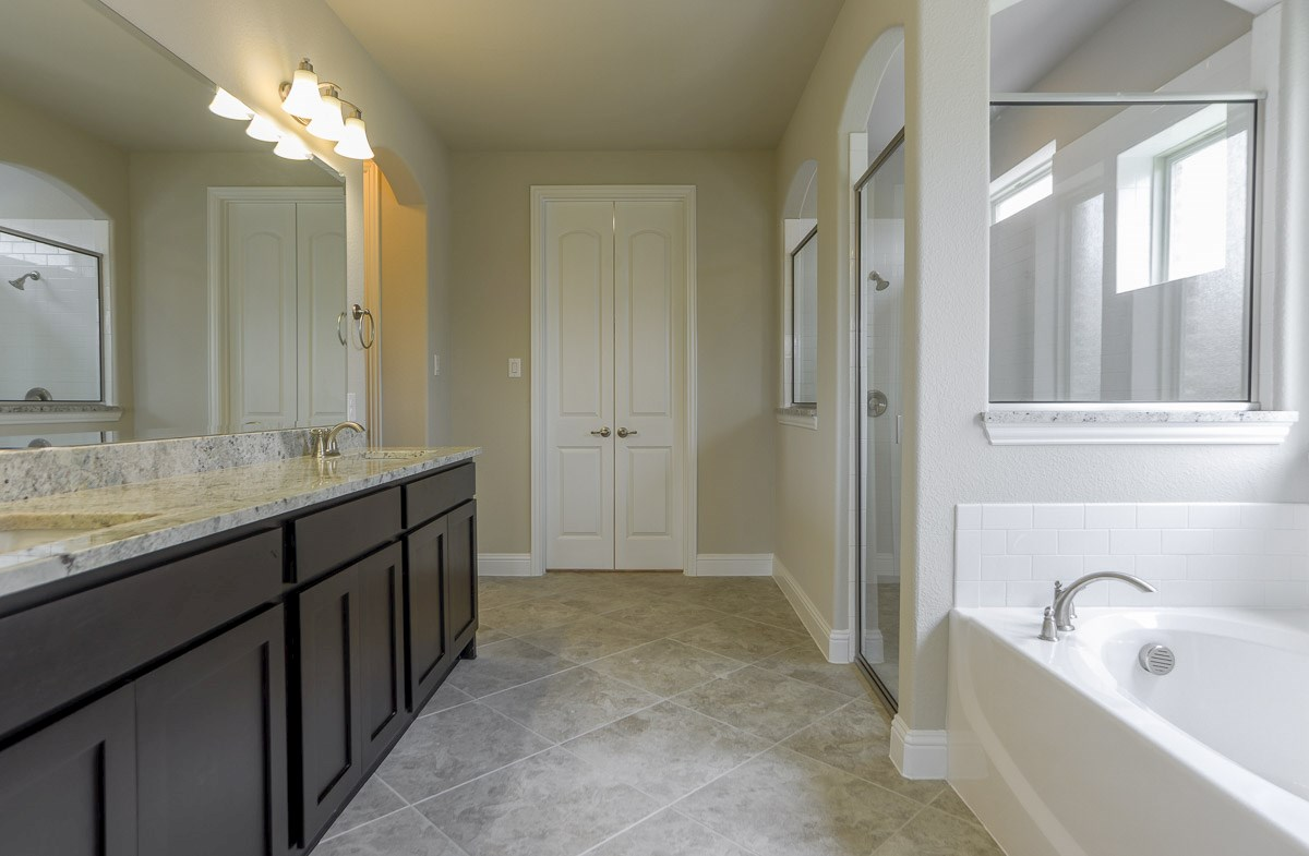 Trinity quick move-in master bathroom with separate tub and shower