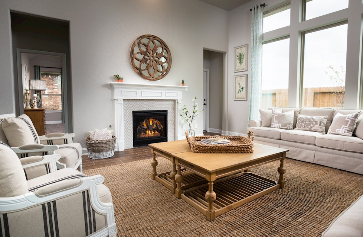 Bridgeland: Parkland Village Capri great room with stone fireplace