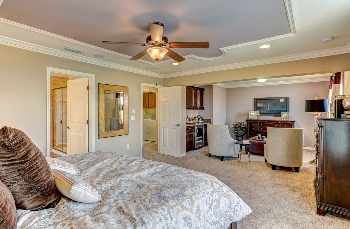 The Reserve at Pradera Captiva Large furnished master bedroom with sitting area