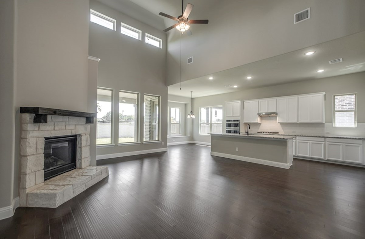 Summerfield quick move-in open great room with fireplace and wood floors