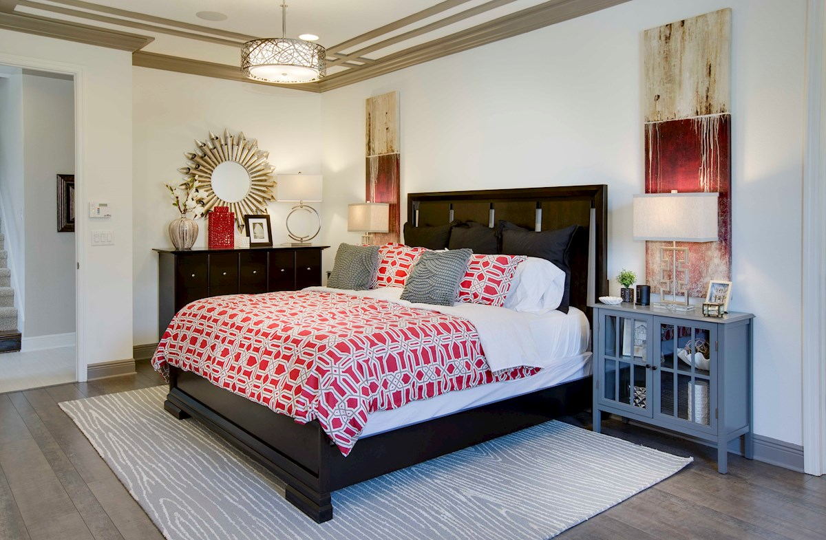Furnished master bedroom with crown modling