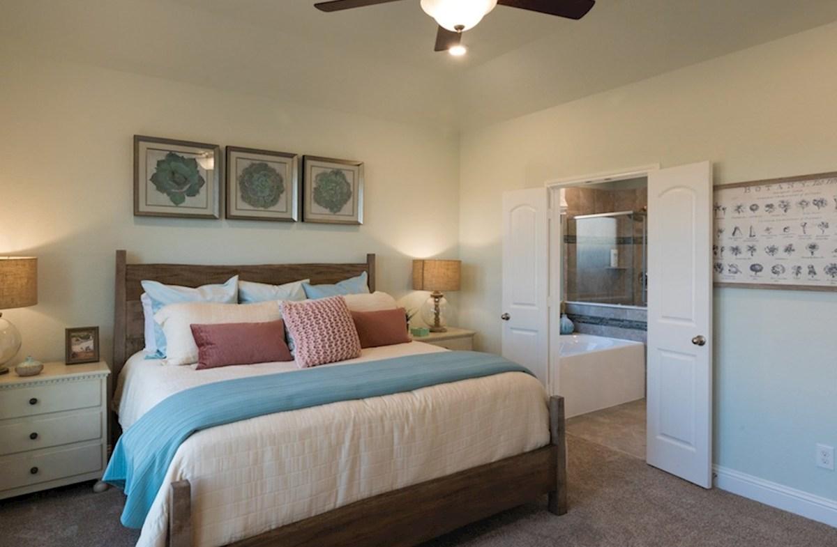 Amira  Alder master bedroom with ceiling fan and carpet flooring