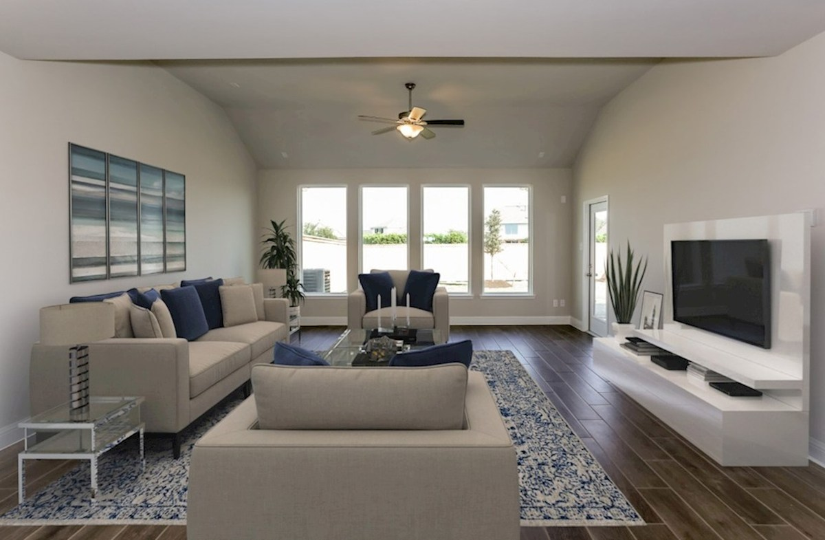Bridgeland: Harmony Grove Woodrose great room with tile flooring and ceiling fan