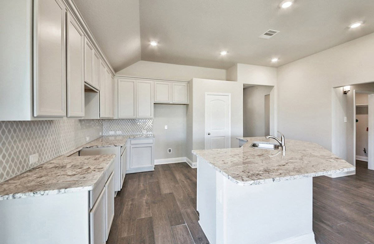 Anderson quick move-in kitchen with granite countertops, tile flooring and stainless steel appliances