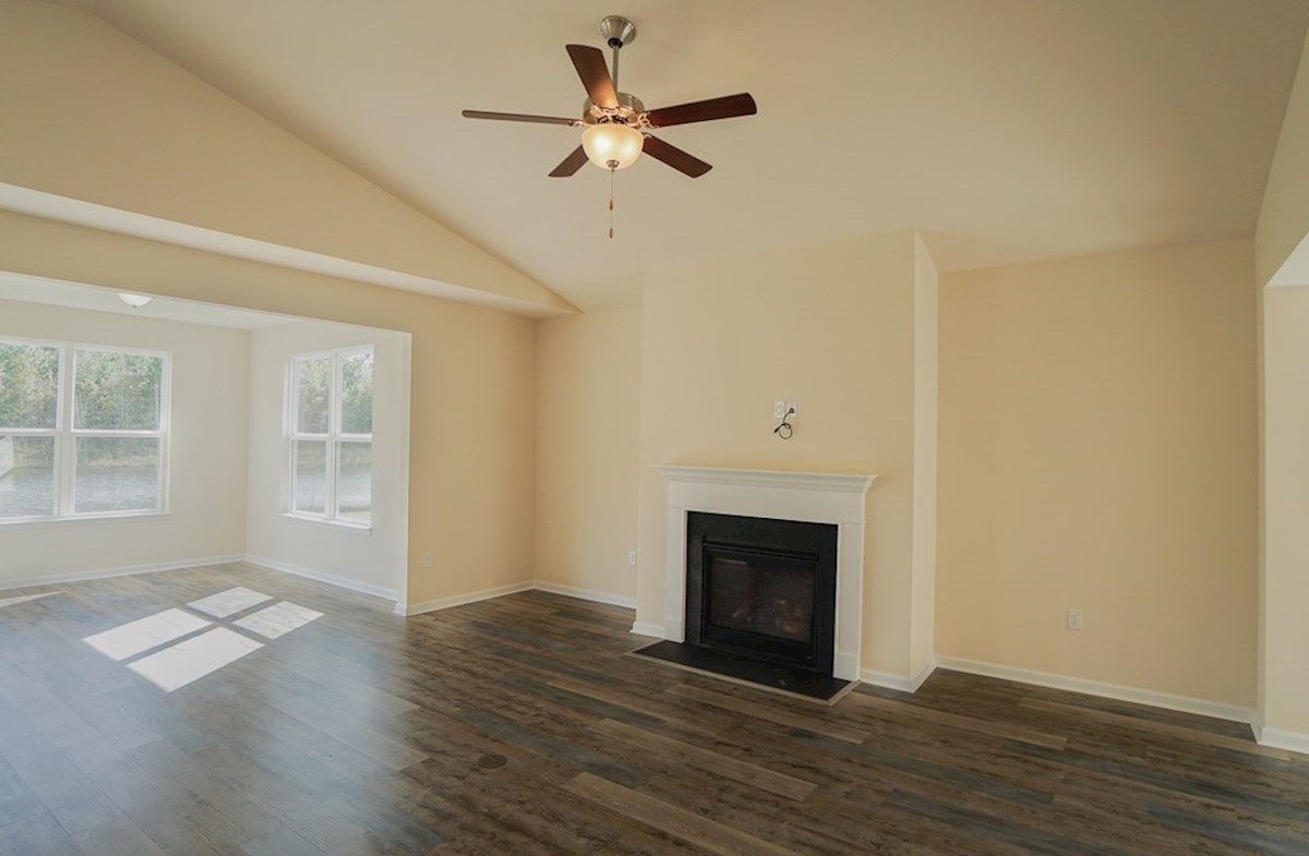 Georgetown quick move-in great room features a natural gas fireplace