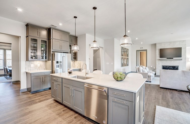 kitchen with center island opening to great room