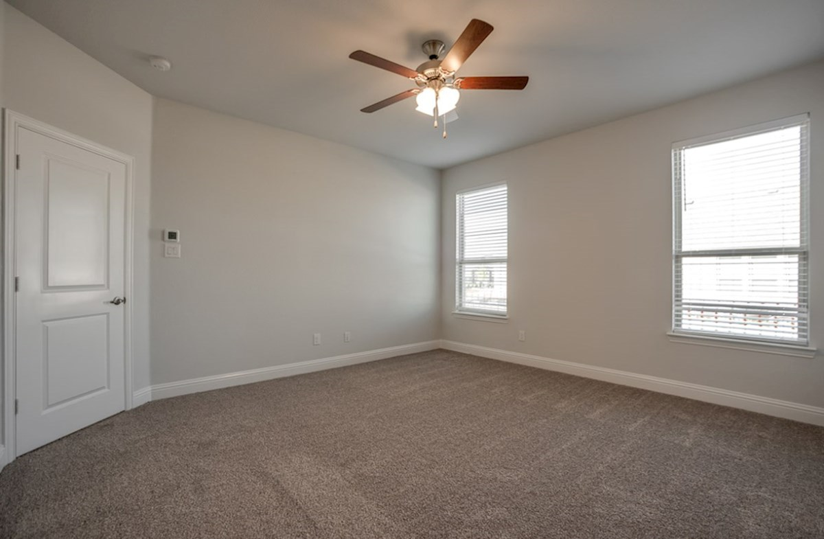 Hamilton quick move-in master bedroom with carpet and ceiling fan