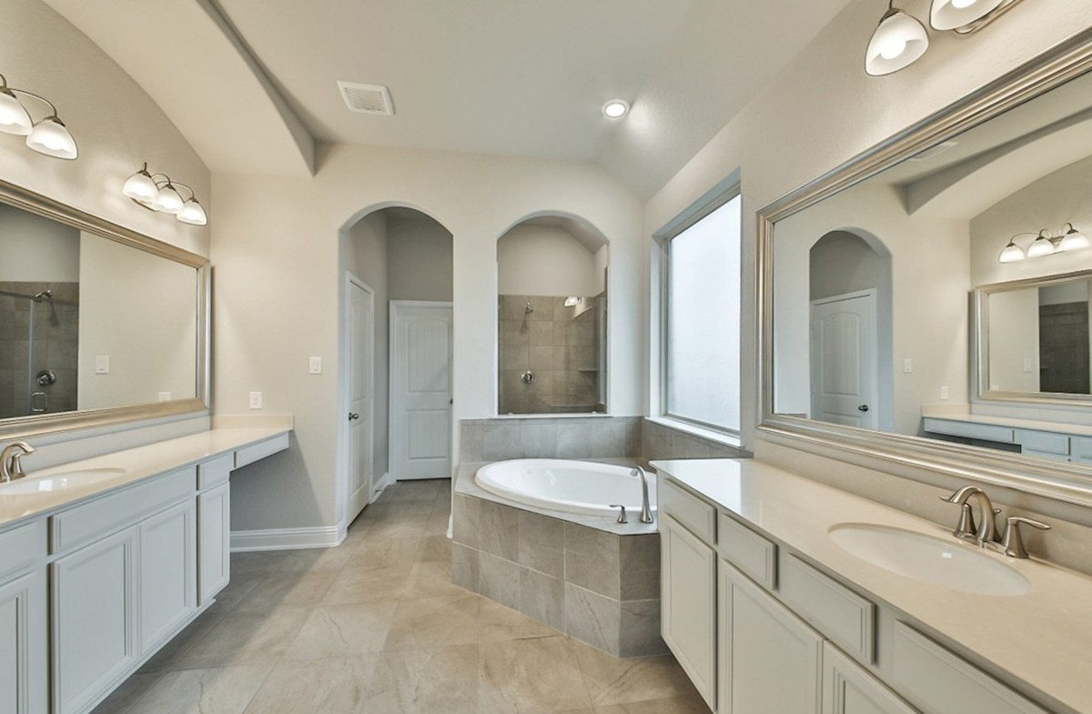 Fredericksburg quick move-in master bath with tile flooring, garden tub and separate shower