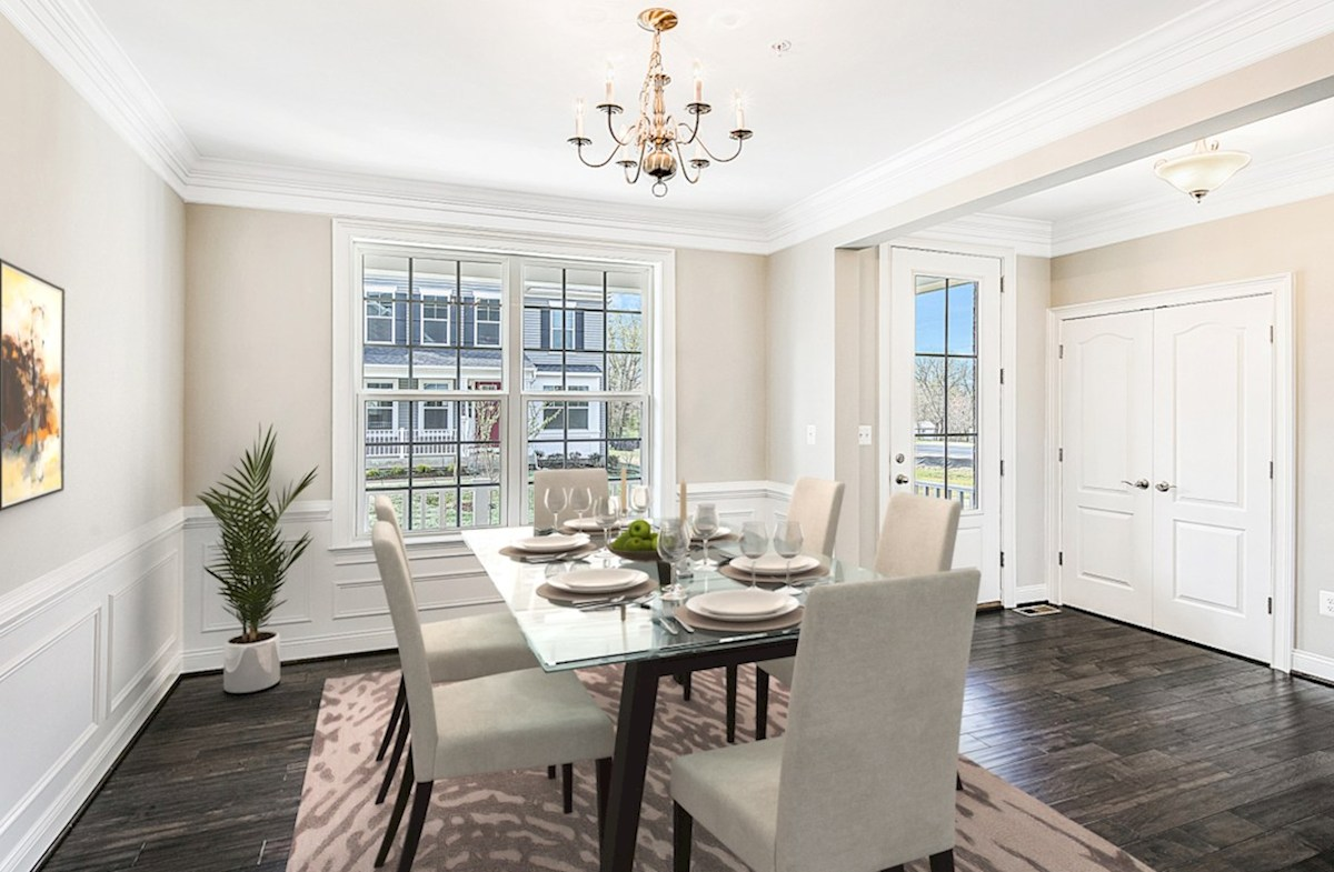 Enclave at River Hill Kingston Kingston foyer and formal dining room featuring hardwood floors