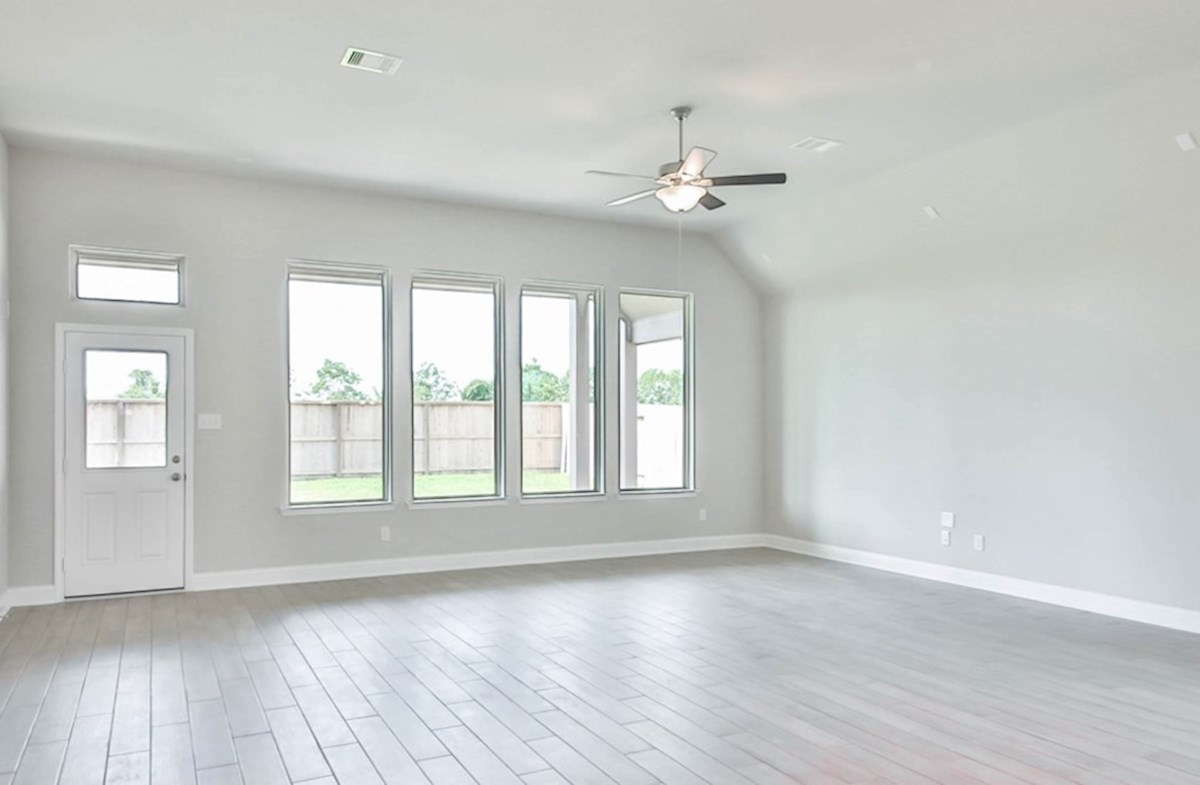 Madison quick move-in great room with tall windows and tile floors