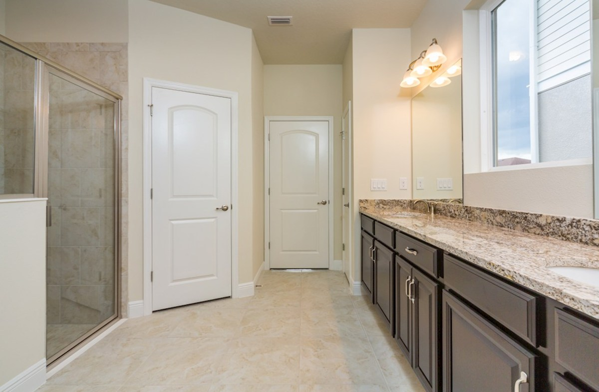 Sea Breeze quick move-in Master bath features dual vanity and dual walk-in closets