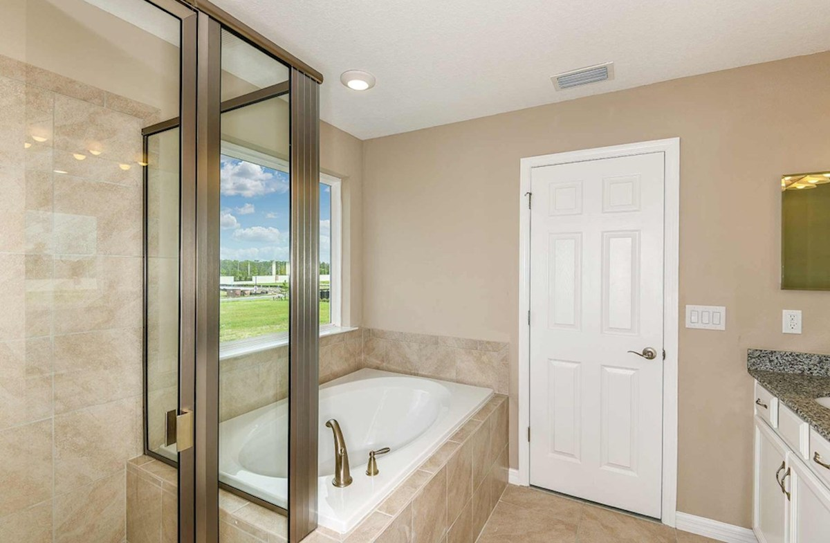 Waterset Seagrass master bathroom with shower and garden tub