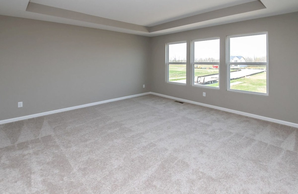 Lawrence quick move-in Relax in this master bedroom with trey ceiling