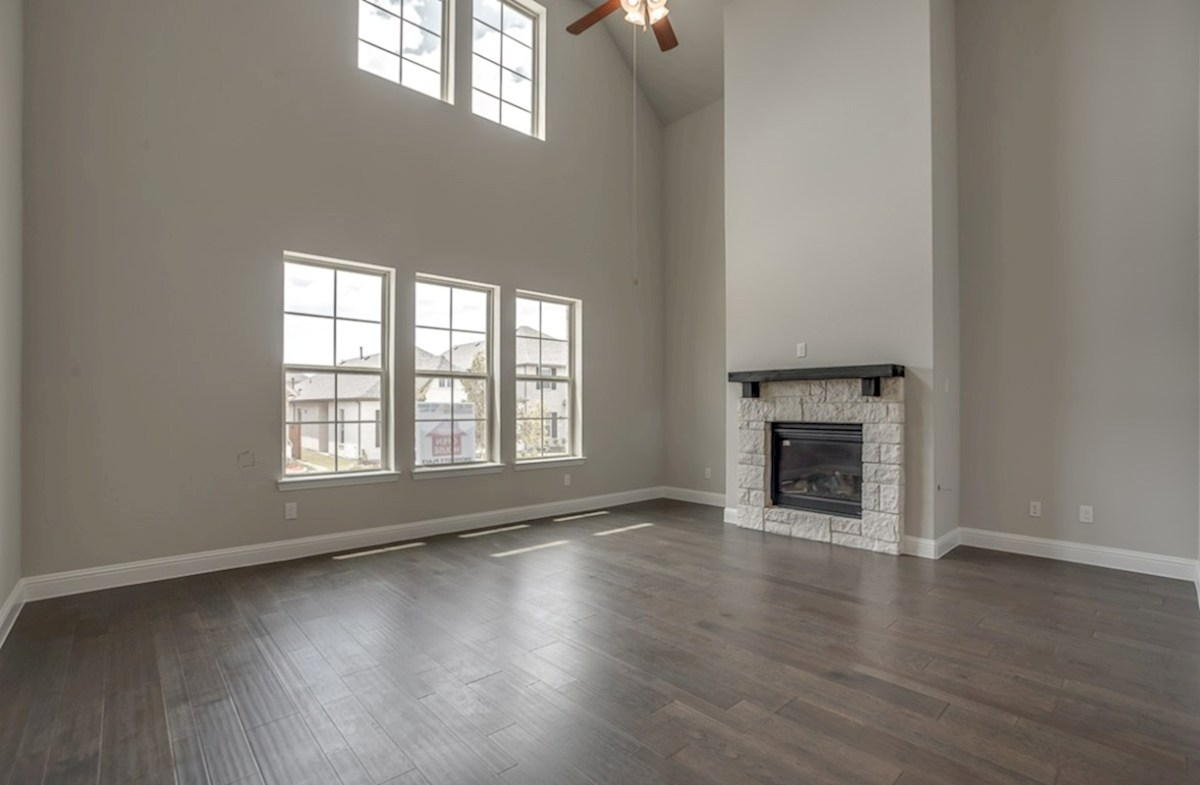 Brenham quick move-in open great room with wood floors, fireplace and tall ceilings