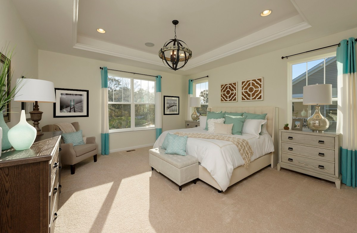 The Estuary Georgetown Large master suite featuring a tray cieling