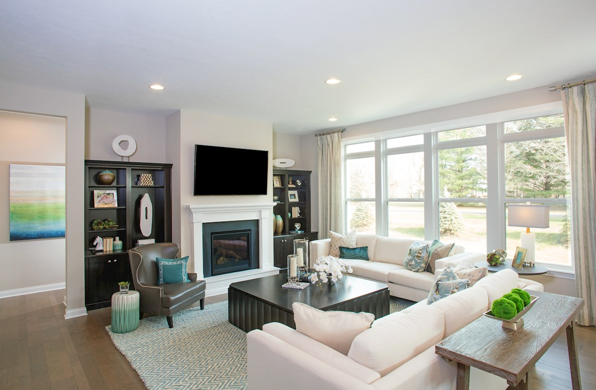 Reserve at Woodside Windsor spacious great room with bookshelves surrounding fireplace