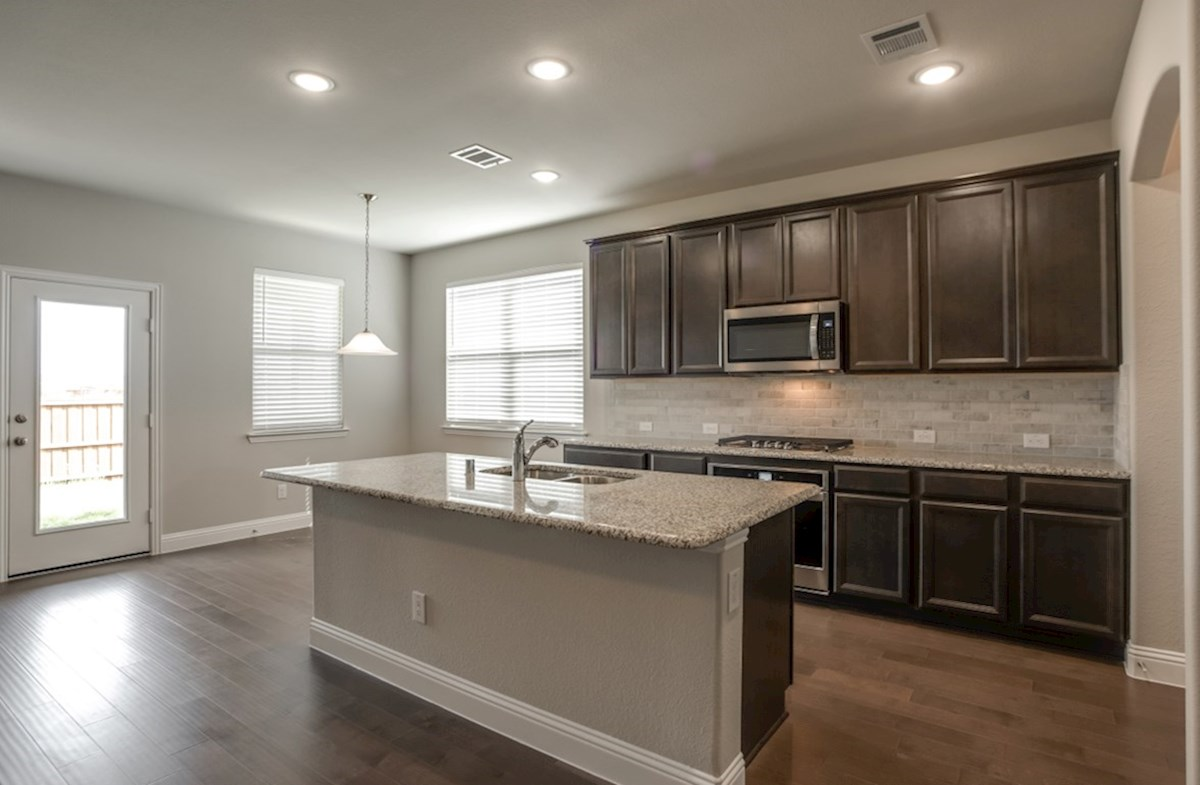 Avalon quick move-in kitchen features stainless steel appliances