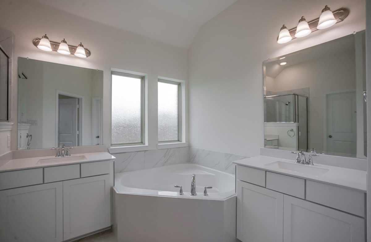 Silverado quick move-in master bathroom with soaking tub and separate vanities